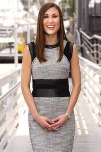 almost full length image of Jessica - white woman with brown hair wearing a black and gray dress